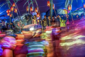 PhotoVivo Honor Mention - Youxia Huang (China)Lantern Show  In Rainy Night